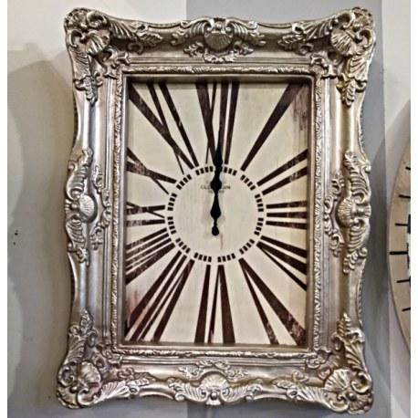 Orologio da parete con cornice barocca in argento