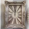 Orologio da parete con cornice barocca in color argento