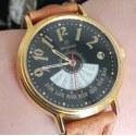 Orologio da polso nero e oro con calendario